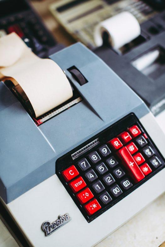 white and red desk calculator