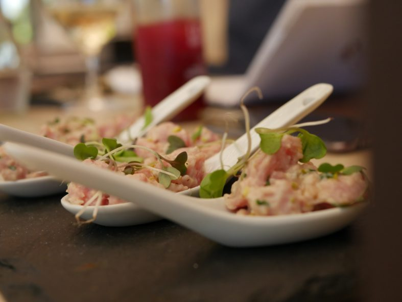 appetizer on white Chinese spoons on table