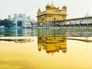yellow temple near body of water